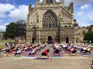Iyengar yogis, including me, taking part in a flashmob yoga practice in front of Exeter Cathedral.